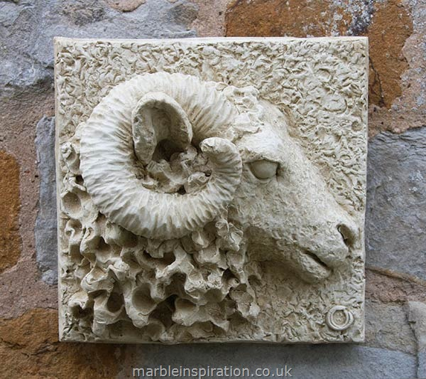 A bonded marble wall plaque featuring a magnificent ram's head. Hand crafted with an Iberian marble and cement fondue and then finished with a stain. This decorative sheep wall plaque is weather resistant and is therefore suitable for hanging on a garden wall or fence. It would also look great displayed on an interior wall.Height 28 cm-Width 28 cm-