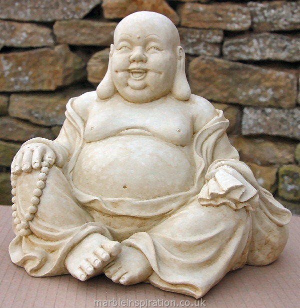 A delightful hand crafted Buddha perfect for sitting in your garden or home. This ornamental Buddha is made with a weather resistant bonded marble - Iberian marble bound with a cement fondue. It features some lovely detailing and is a great choice to create a happy, calm environment.Height 24 cm-