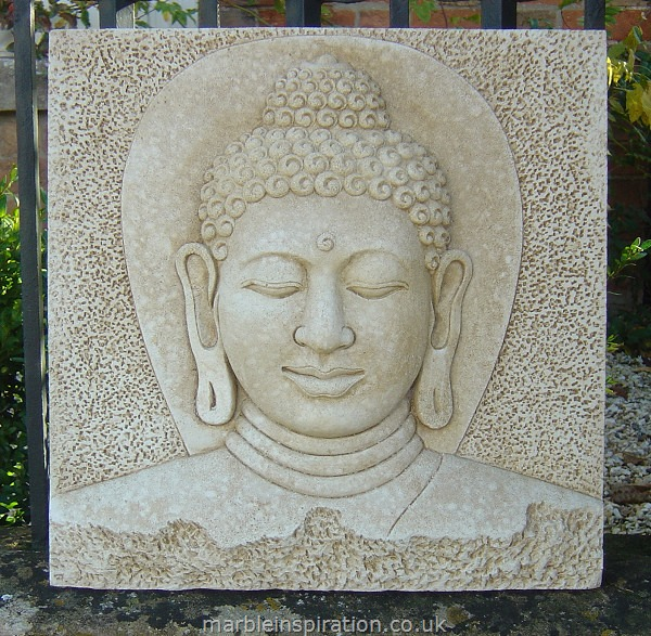 A Buddha wall plaque hand crafted with fine detail and finished with a stain to produce a subtle aged appearance. This stunning garden ornament is made with a weather resistant bonded marble - Iberian marble bound with a cement fondue. It has a metal hook on the back and can be hung on a wall or placed free standing to create a calm, serene atmosphere in your garden or home.Height 38 cm-Width 38 cm-