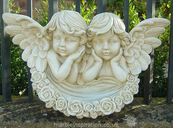 This is a very striking marble garden ornament designed with two beautifully crafted angels. The bowl shaped front adorns a garland of roses with fine detailing. It is made from a weather resistant bonded marble - a mix of Iberian marble and a cement fondue. A unique decorative piece of garden art for hanging or placing in a focal spot to create an eye catching feature. -Height 25 cm-Width 45 cm-
