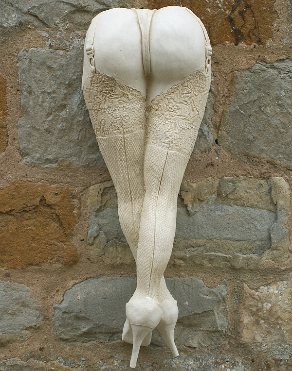 This sculptural wall decoration features a 'cheeky' pair of legs with finely detailed stockings. It is made with a weather resistant Iberian marble and cement fondue to produce a unique decorative ornament with a sense of fun. This wall ornament is suitable for both exterior and interior display and has a metal hook on the back for hanging. -Height 47 cm-Width 17 cm-