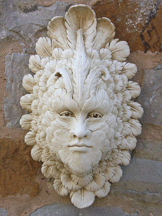 A stone face hanging ornament perfect for a garden wall or anywhere either inside or outside your home. It is made with a weather resistant Iberian marble and cement fondue. This outstanding green man style ornament is crafted with a feather design and lifelike eyes. An ideal choice for creating a unique garden feature.Height 42 cm-Width 26 cm-