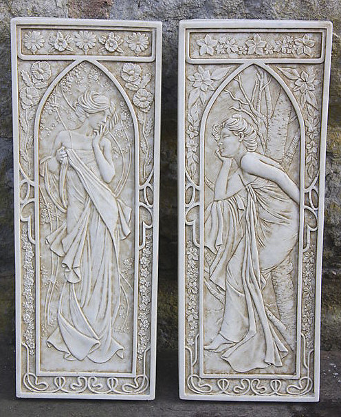 A pair of Art Nouveau design wall plaques depicting winter and summer. These wall hanging plaques feature beautiful detail and are weather resistant. They have a metal hook on the back for hanging and are made from an Iberian marble and cement mix. An ideal choice to enhance your garden or interior decor.Height 31 cm-Width 13 cm-